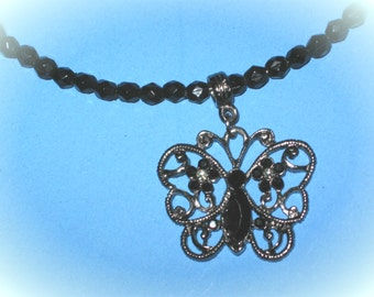 """1"""" Metal Butterfly Charm on Black Beaded Wire Choker Necklace"""