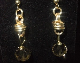 Gold Coil Drop Earrings with Large Brown Crystals