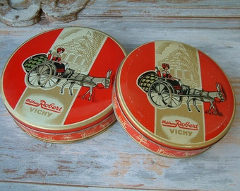Antique french lithographed round candy tins. Chateau Robert Vichy. Set of 2. Red and gold. Antique collectors tin.