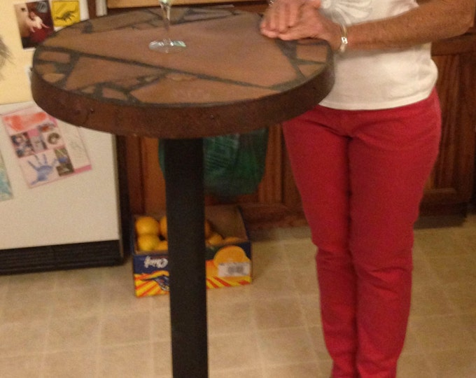 "Tall Boy: Stone topped bar table 23"" top diameter 43""  tall."