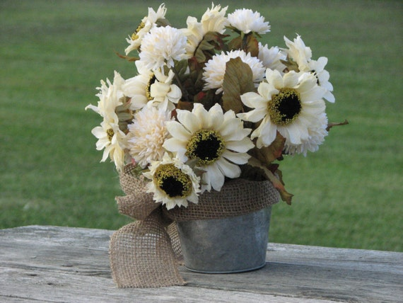 Rustic centerpiece cream colored silk flowers in tin bucket