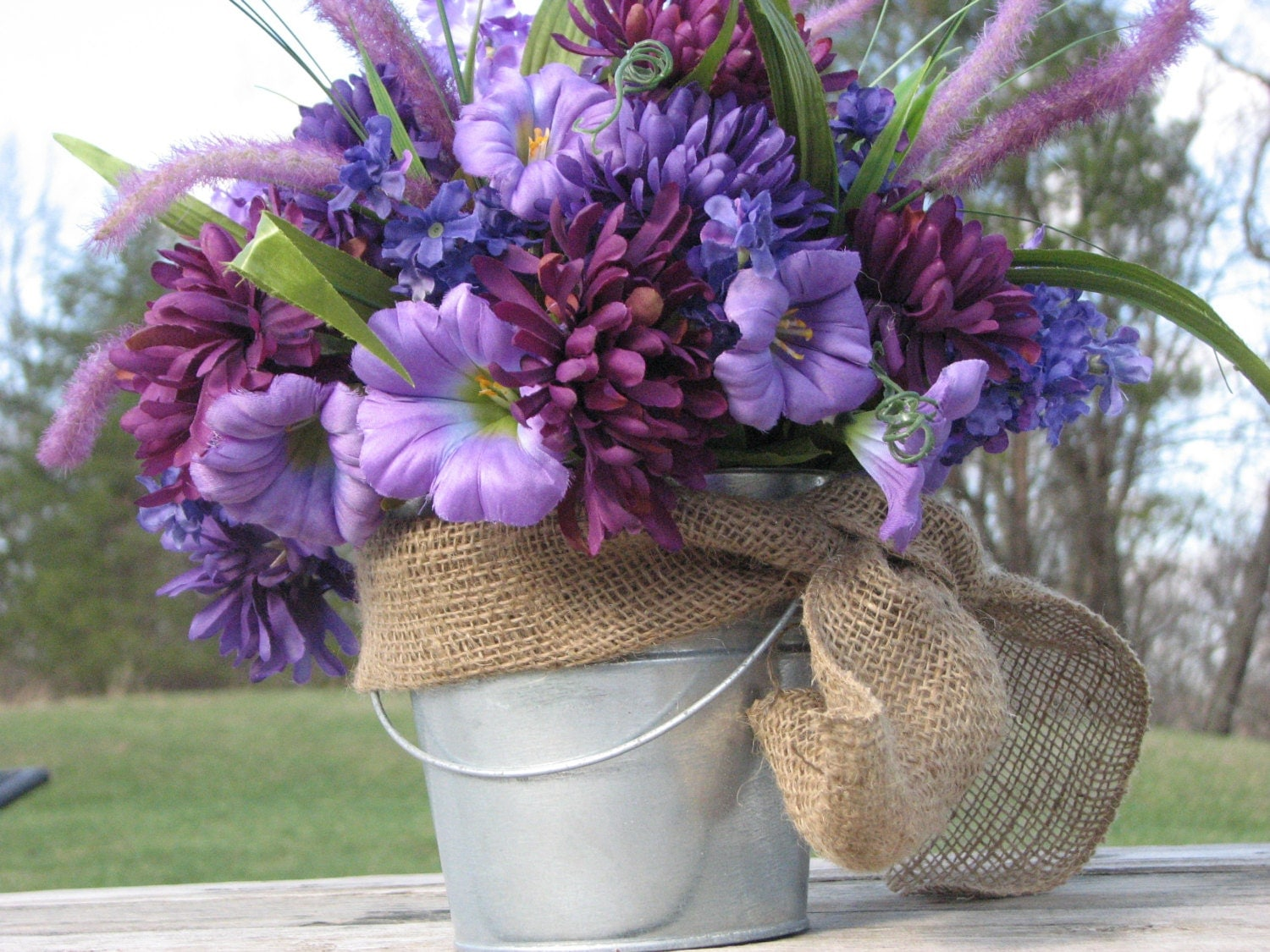 Rustic centerpiece silk floral arrangement purple flowers
