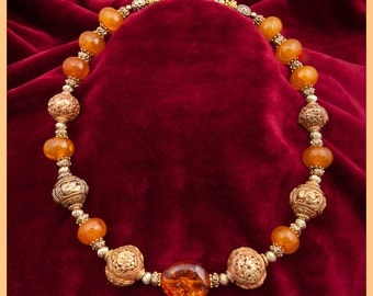 Choice Amber and chased Gold necklace of traditional Tibetan chased gold over bronze, Baltic clear and cloudy amber and vermeil.