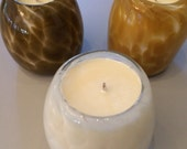 A trio of scented soy candles in hand-blown vessels
