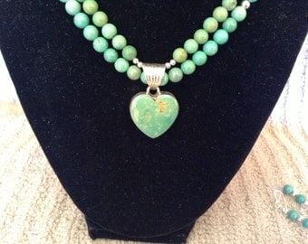 Double strand of nat'l turquoise beads with sterling spacer beads and sterling toggle clasp and turquoise heart pendant