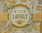 """Handmade, Hand stamped Feminine 'I think you're Lovely"""" Greeting Card with yellow flowers and green accents"""