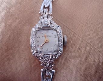 Vintage 50s 14k WG Bulova ladies diamond watch, full diamond bracelet