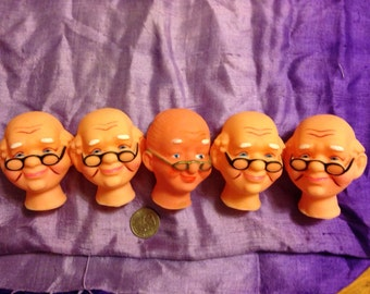 Five flexible plastic heads designed for medium-sized dolls would be perfect for older dolls, whether kindly or creepy characters