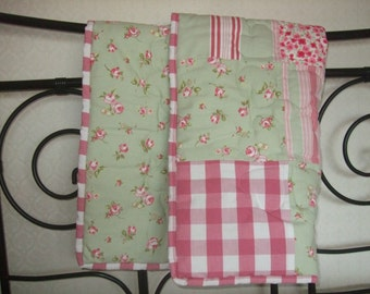 A beautiful handmade baby cot quilt.  .