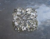 Signed Weiss brooch with 3 tiers of clear rhinestones