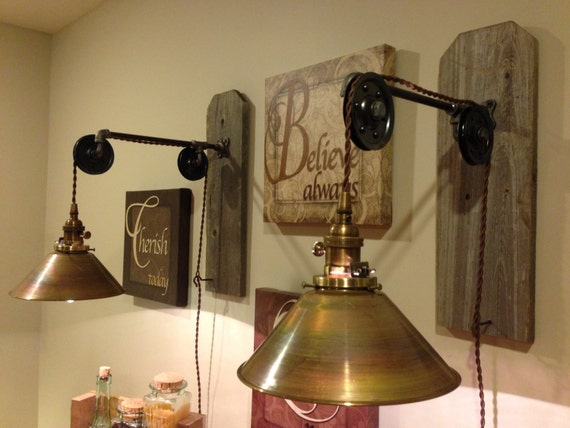 Items similar to Wall hanging industrial pendant light with pulleys and brass shade on Etsy