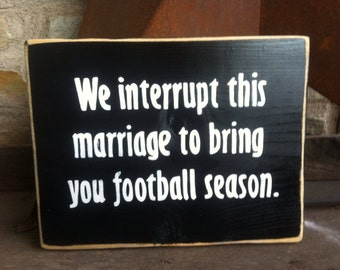 Hand painted wooden sign - We interrupt this marriage to bring you football season.