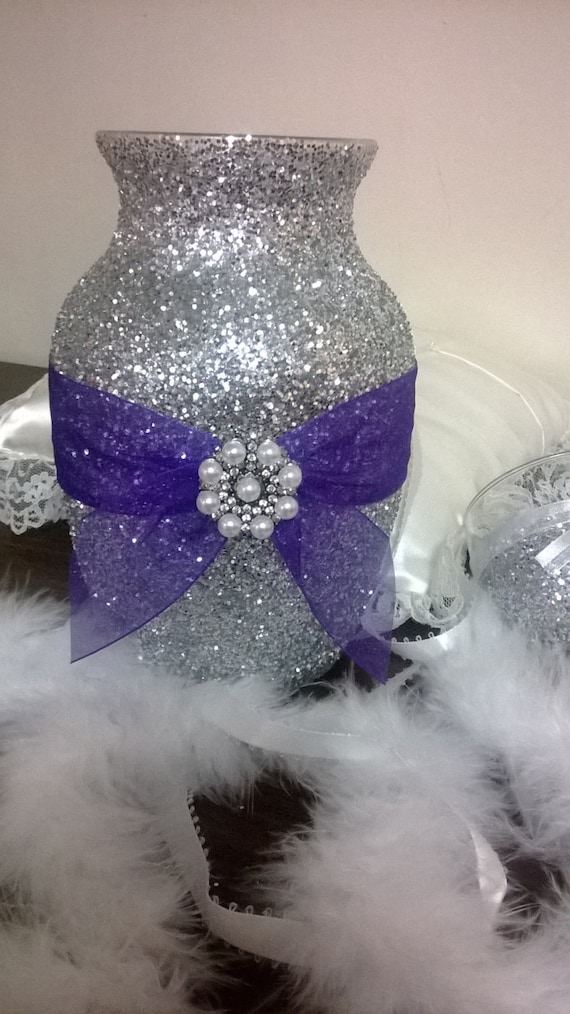 Silver glitter vase with purple ribbon wedding centerpiece