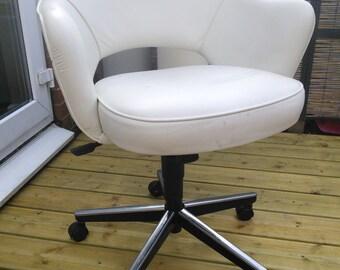 A swivel chair by Eero Saarinen.  Made by Knoll