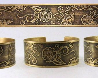 """1"""" metal cuff with etched Multiple Henna Flowers design."""