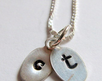 Personalized, hand-stamped, sterling silver, initials charm necklace.