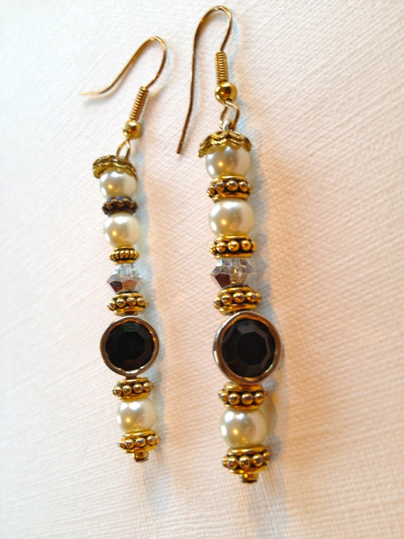 Pearl, golden, shimmering and metal circled black beaded earrings