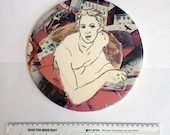 Ceramic tile with figure of St Matthew approximately 20cm in diameter, using monoprint and transfer decoration