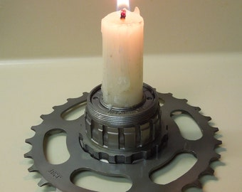 Repurposed candle holder bicycle hub mounted to gear