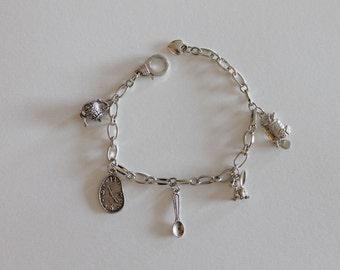 Alice aged silver charm bracelet