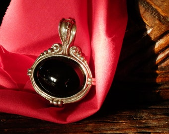 Pendant of silver and jet black.