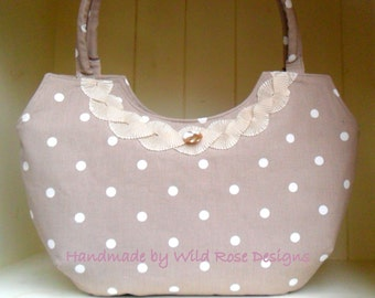 Handmade handbag in a taupe and off white spot print cotton with a pleated trim.