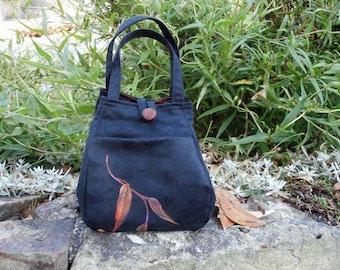Black fabric handbag . Small handbag. Folds flat for travel. Handpainted gum leaves. Easy care. Handmade.