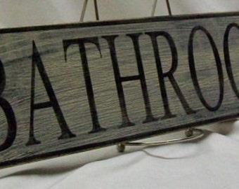 "Bathroom wall sign, 4 1/4"" x 17"", distressed"