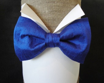 "Bow tie, pre tied or self tie bow tie in electric blue silk dupion, will fit neck size upto 20"" (50cms)."