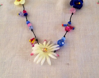 pink and blue bead and flower necklace