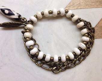 Cream and bronze bead bracelet with bronze chain detail