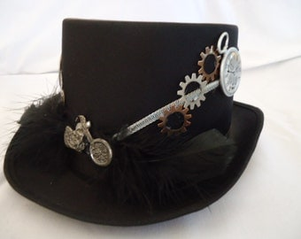 Steam punk top hat , gears and keys for adornments