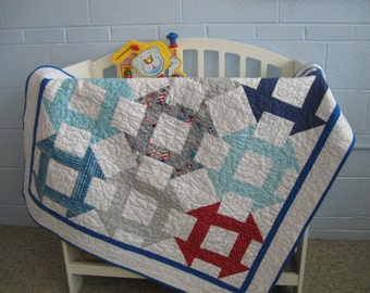 Free shipping in the U.S. for the Modern Churn Dash Baby Quilt
