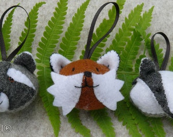 Three little animalsheads, for keychains. The Fox, The Raccoon and the Badger.