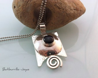 Texturized sterling silver with onix pendant.  Black pendant with spiral detail