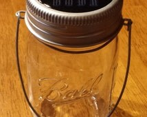 Hanging Mason Jar Solar Lid Light - Color Changing LED - Includes 1 Clear Mason Jar and Handmade Hanger - Lid Light Changes Color