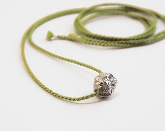silver small knot pendant with silk cord