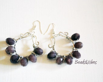 Silver earrings and purple petals