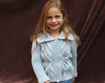 Knitted girl sweater. Knitted girl cardigan. Grey girl sweater. With buttons in the front. Age 4-5