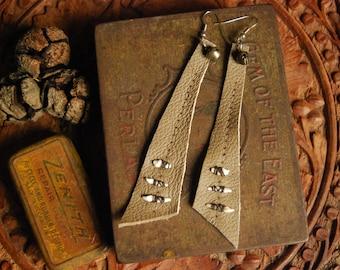 Two Hunters - recycled leather + fox teeth earrings.