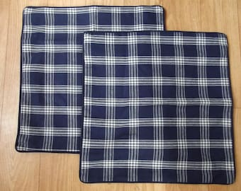 set of two blue chequed cushion covers