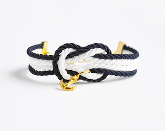 Navy blue and white forever knot nautical rope bracelet with gold anchor and ship wheel charms // adjustable nautical bracelet