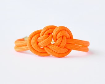 Bright neon orange adjustable triple knot parachute cord nautical rope bracelet with petite gold anchor charm