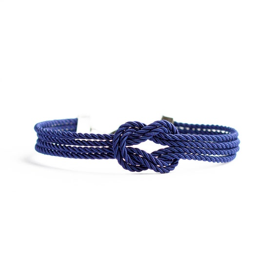 Navy blue forever knot nautical rope bracelet with silver anchor charm