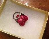 Red jeweled handbag style brooch
