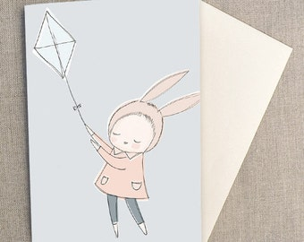 "Greeting Card - Bunny Girl Flying a Kite, Light Blue -  C6 greeting card 11w x 15.5 h cm (4.4x6.1"")."