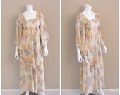 Vintage gauzy Goddess dress. 1970s. Tiered, pleated, sheer gauze, pastel floral print, angelwing sleeve, maxi dress.