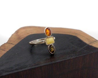 Three stoned amber ring in a sterling silver setting sizes 7.5 and 8