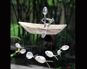 Paddle Trip, Spoon Man, and Fish Wind Chime, kayak white water, boat oar, boat paddle, model ship, man in boat, life jacket, life saver,