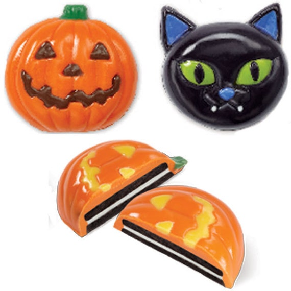 Turn store-bought cookies into candy-coated treats Cat and Pumpkin Cookie Candy Mold Wilton
